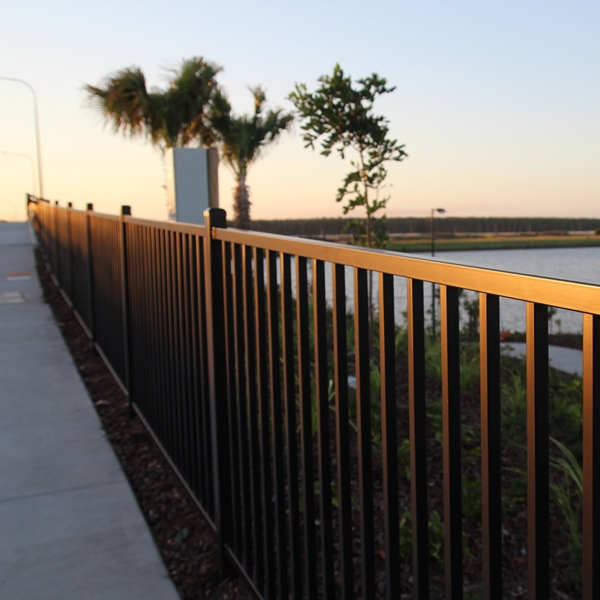 Fencing in a 1200mm high Flat Top style installed on a shared path on a bridge on the Sunshine   Coast prevent pedestrians injuring themselves by accidentally falling off the bridge.