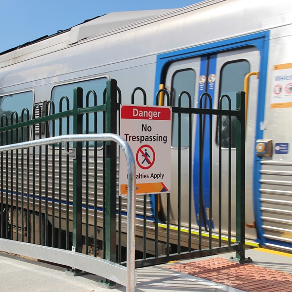 Fencing in a 1200mm high Loop Top style along a rail platform in Adelaide prevents passengers   injuring themselves by accidentally falling off the platform, and restricts unauthorised access to   the tracks.