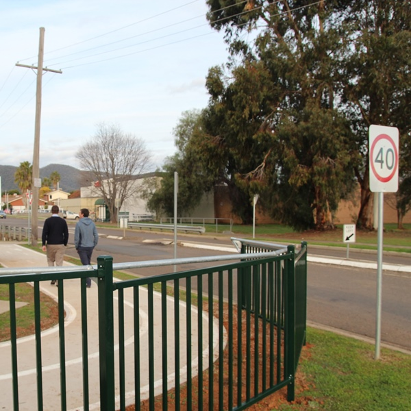 The CycSafe® full barrier in a powder coated finish addresses a sweeping bend at the corner of busy   intersection Tamworth, NSW.