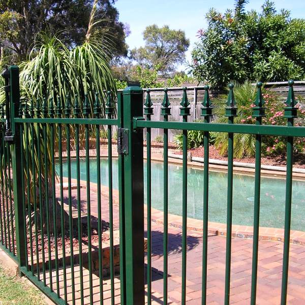 Pool'nPlay® tubular steel pool fencing in a level Cardinal spear style with a heritage green powder coated finish.