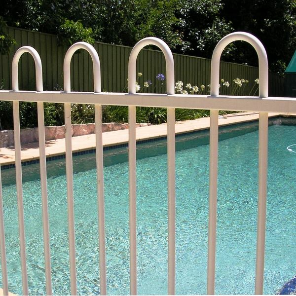 Pool'nPlay® powder coated tubular steel fencing in a loop top style with a primrose powder coated finish.
