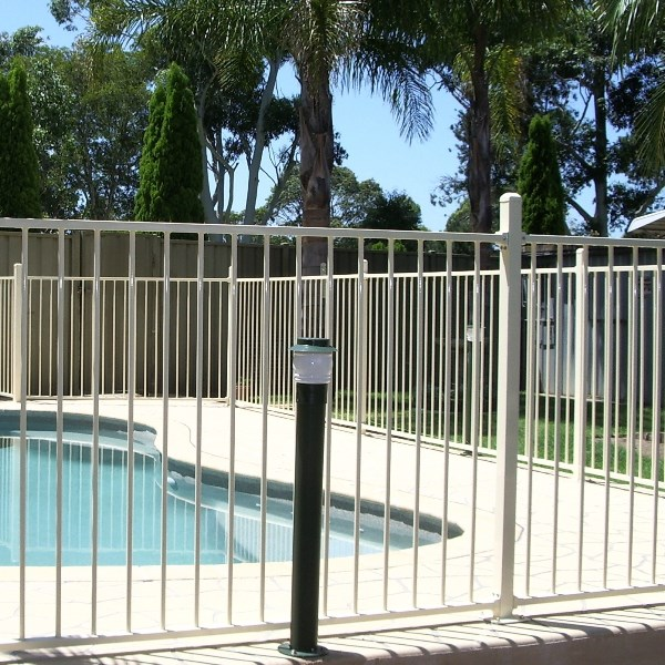 Pool'nPlay® tubular steel pool fencing in a flat top style in a primrose powder coated finish.