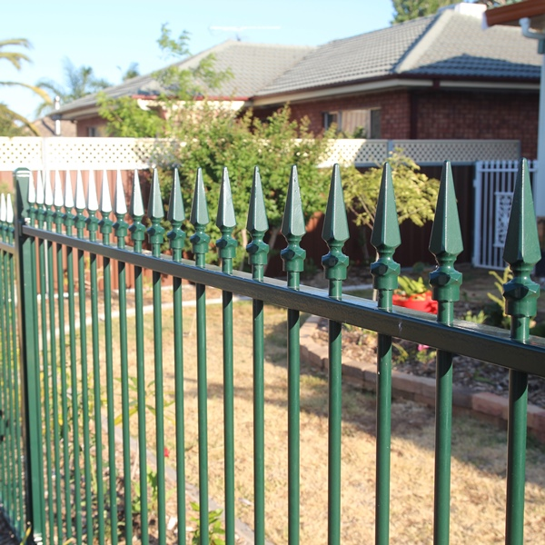 Smart'nSafe® powder coated tubular steel fencing in a level Carthage spear style with a heritage green powder coated finish.