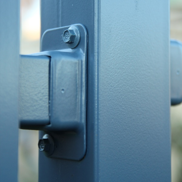 A powder coated bracket is used to connect the fence panel to the post with a series of self-drilling tek screws.