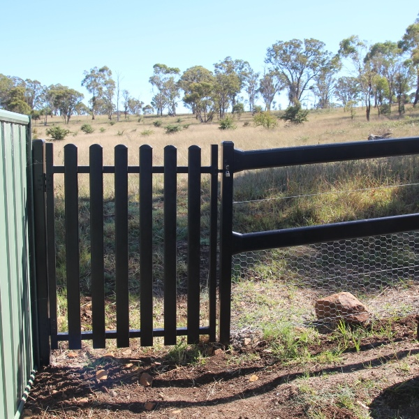 A steel picket side gate goes well with the TopRail fence.